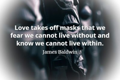 Ancient wooden head sculpture with James Baldwin quote, Love takes off masks that we fear we cannot live without and know we cannot live within.