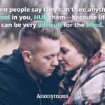"""Couple in an embrace with woman staring at man with quote, """"When people say they can't see anything good in you, hug them."""""""